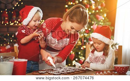 Happy Funny Mother And Children  Bake Christmas Cookies