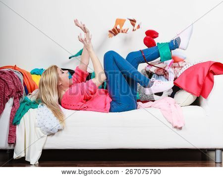Mess At Home, Household Duties Disorganization Concept. Woman Lying On Sofa, Pelted Clothes