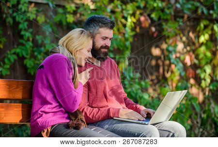 Family Surfing Internet For Interesting Content. Couple In Love Notebook Consume Content. Internet S