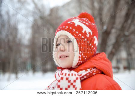 Winter Portrait Of Kid Boy In Colorful Clothes. Active Outoors Leisure With Children In Cold Snowy D