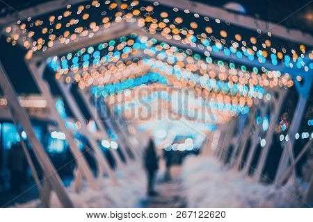 Blurred City With Christmas Lights At Night. New Year Bokeh