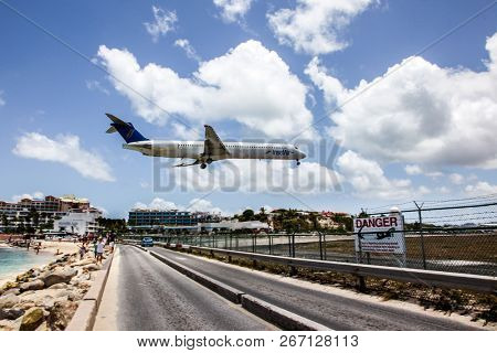 MAHO BAY BEACH  AUGUST 01: Aeroplane InselAir is landing on Princess Juliana International Airport, over Maho Bay Beach seen in St.Martin/St.Maarten on August 1, 2015