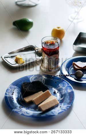 Glass of tea with glass holder. Breakfast table.
