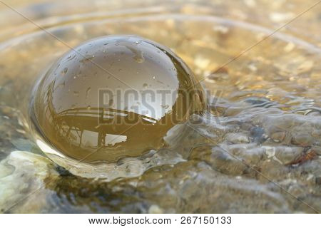 Round Clear Glass Sphere In The Water