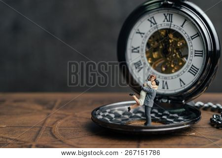 Miniature People Happiness Couple Figure Standing On Vintage Pocket Watch, Husband Holding His Wife