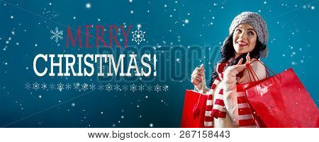 Merry Christmas Message With Young Woman Holding Shopping Bags