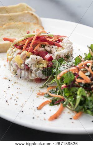 raw marinated sea bass fish ceviche salad modern gourmet fusion cuisine starter set in melbourne australia restaurant poster