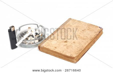 old book with cigarettes in ashtray