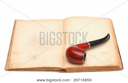 Opened empty old book with vintage pipe on white