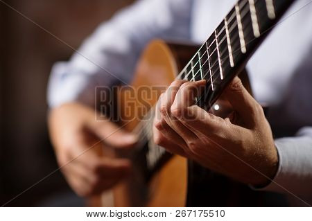 Close Up Of Guitarist Hand On Classical Guitar. Selective Focus, Shallow Depth Of Field.