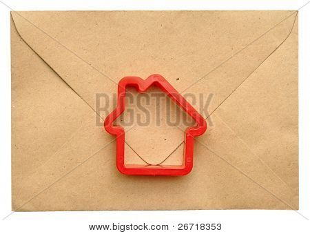 toy house on the sealed envelope