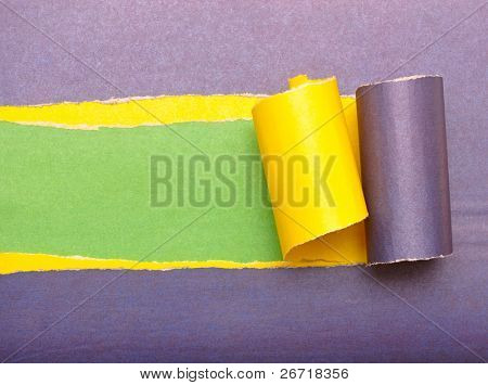 torn paper with space for text with yellow and green background