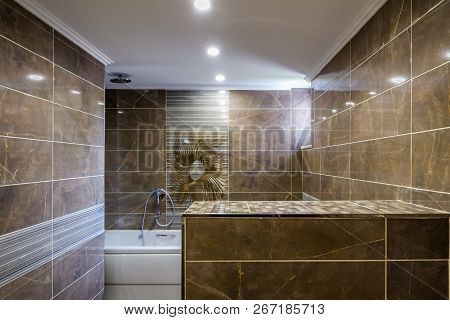 Modern Bathroom Decorated With Marble Walls, White Bath Tube