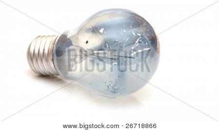 Broken lightbulb on white