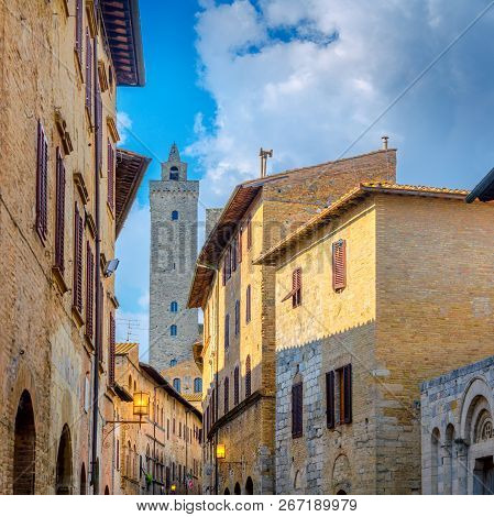 street of the old city of Siena overlooking the tower of Torre del Manja, Sienna. Italy