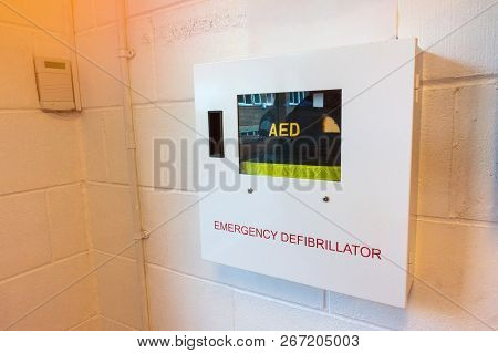 Aed (automated Extenal Defibrillator) - Heart Defibrillator Hanging On The Wall In International Sch