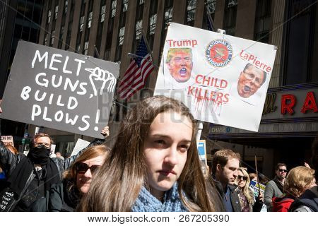 March For Our Lives: Participants in the march to end gun violence on 6th Ave hold signs with various phrases including Melt Guns Build Plows, NEW YORK MAR 24 2018.