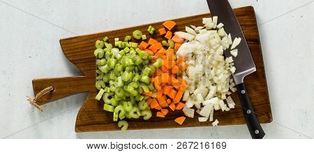 Banner Of Chopped Vegetables And A Chef's Knife On A Wooden Cutting Board. Basic Cutting For Restaur