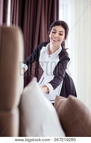 Joyful Professional Hotel Maid Cleaning The Room