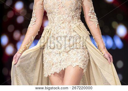 Sofia, Bulgaria - 19 September 2018: Female Model Walks The Runway In Beige Dress During A Fashion S