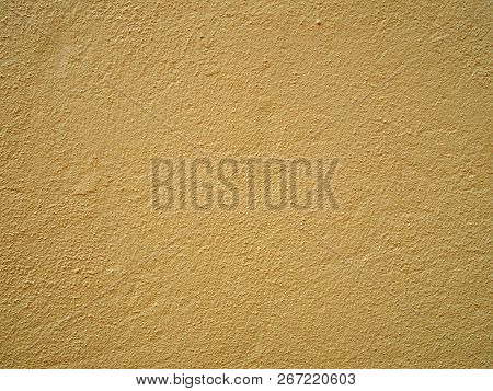 A Rough Textured Gritty Pale Yellow Concrete Wall Of Floor Surface Background