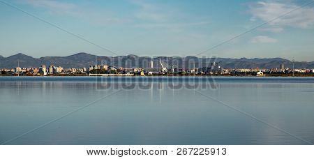 Valencia City Skyline And Albufera Rice Fields
