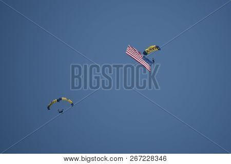 U.s. Navy Parachute Team Leap Frogs With Giant United States Of American National Flag Performing Du