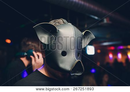 A Corporate Man In A Dirty Scruffy Suit Wearing A Black Pigs Mask In A Dark Sinister Background, Pho