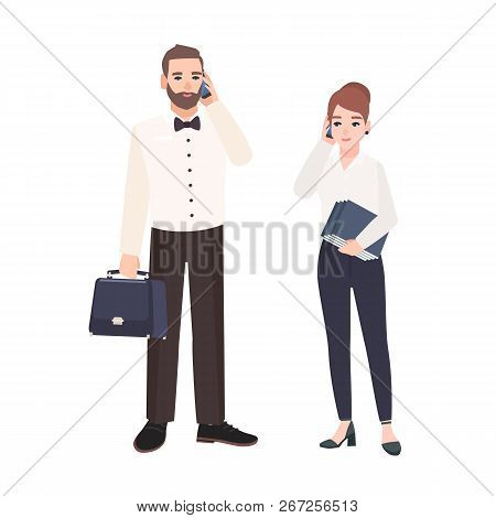 Pair Of Clerks Dressed In Business Clothes Standing And Talking On Phone. Busy Male And Female Offic