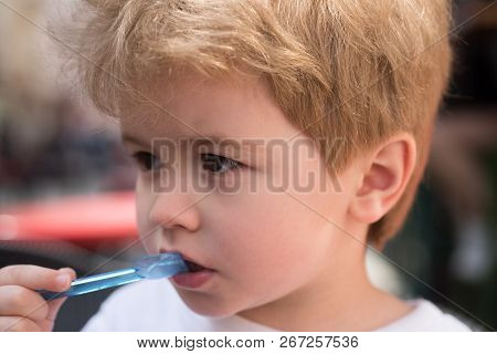Great Haircut. Healthy Hair Care Habits. Little Child Eating Outdoor. Small Boy With Stylish Haircut