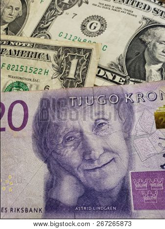 Swedish Banknote Of 20 Kronor And American Dollar Bills Background Texture