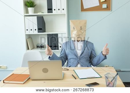 Business, Emotions And Money Concept - Office Crazy Man Put A Package With Painted Funny Face On Her