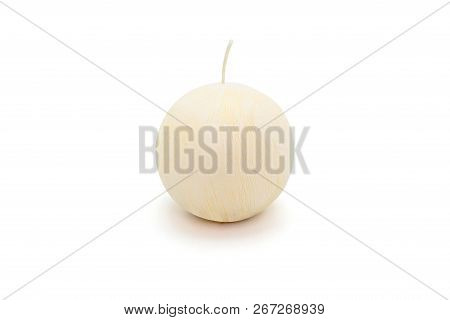 White round, paraffin candle lies on a white background with a clipping path. poster