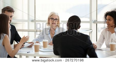Diverse Employees Negotiate During Business Meeting In Office