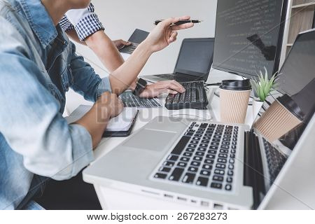 Programmers Cooperating At Developing Programming And Website Working In A Software Develop Company