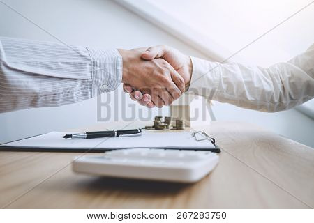 Real Estate Broker Agent And Customer Shaking Hands After Signing Contract Documents For Ownership R