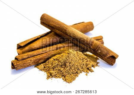 Cinnamon Stick And Cinnamon Powder Isolated On White Background