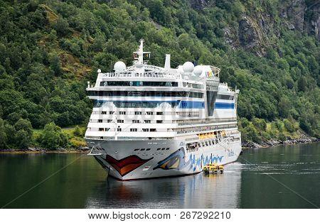 Geiranger, Norway - July 17, 2017: The Cruise Ship Aidabella Of The Shipping Company Aida Cruises Ha