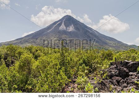 Volcano Arenal Behind A Lava Field In National Park Arenal, Costa Rica