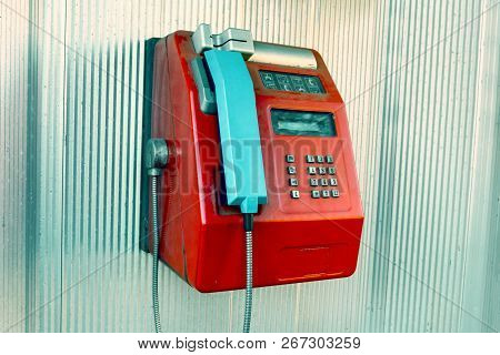 Red Public Phone In A Phone Booth.