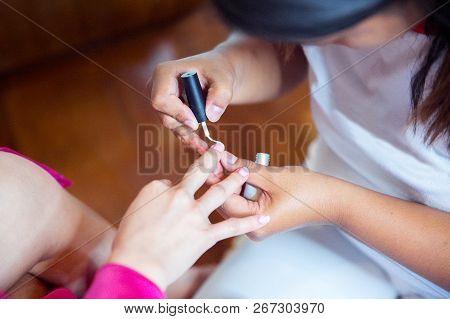 Wedding Preparations. Manicure Master Paint Nails With Nail Polish Close-up.