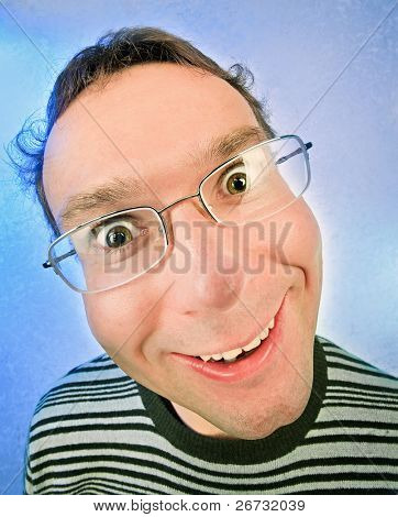 Funny surprised man in glasses portrait on vivid color background