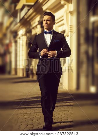 Confident Businessman. Young Man Wears Suit And Bow Tie With Confidence.