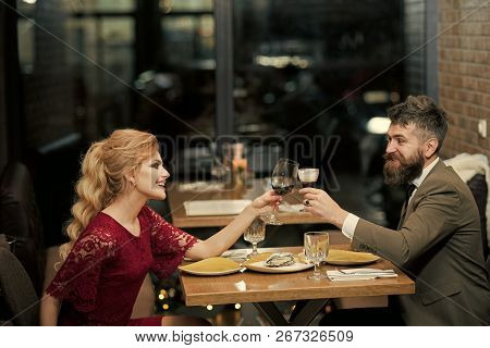 Couple In Love At The Restaurant. Proposal And Anniversary. Valentines Day With Sexy Woman And Beard