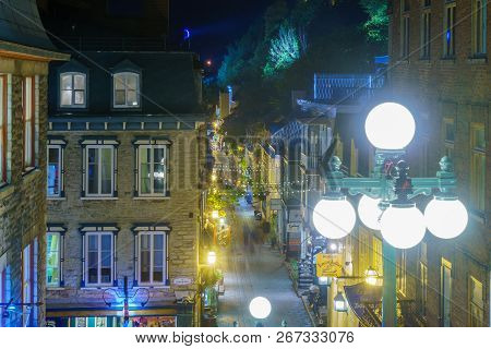 Quebec City, Canada - September 26, 2018: Night View Of The Rue Du Petit Champlain Street With Local