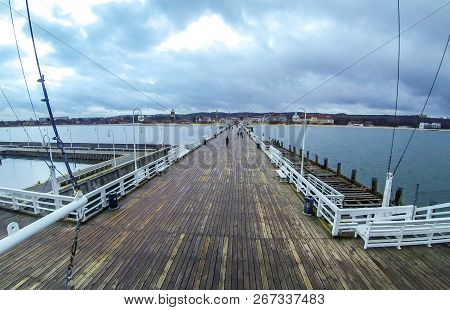 People Walking On A Pier (molo) In Sopot City, Poland. Built In 1827 With 511m Long It Is The Longes