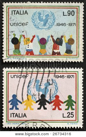 ITALY - CIRCA 1971: two stamps printed in Italy celebrates the 25th anniversary of UNICEF, the United Nations Fund providing assistance to children  in developing countries. Italy, circa 1971