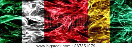 Italy Vs Guinea, Guinean Smoke Flags Placed Side By Side. Thick Abstract Colored Silky Smoke Flags