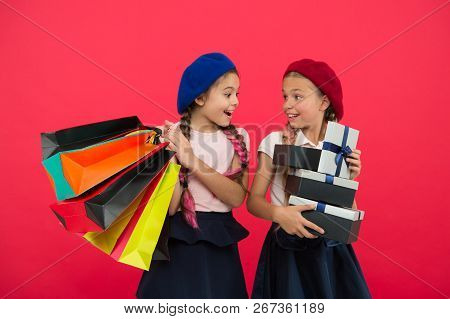 Shopaholic Concept. Shopping Become Fun With Best Friends. Children Satisfied By Shopping Red Backgr