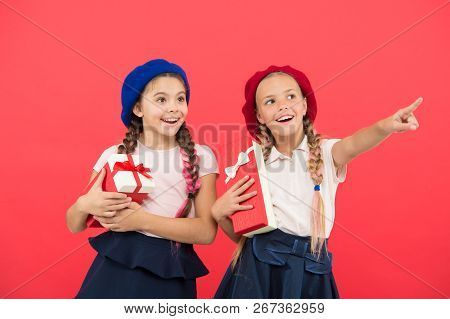 Children Excited About Unpacking Gifts. Small Cute Girls Received Holiday Gifts. Bring Happiness To